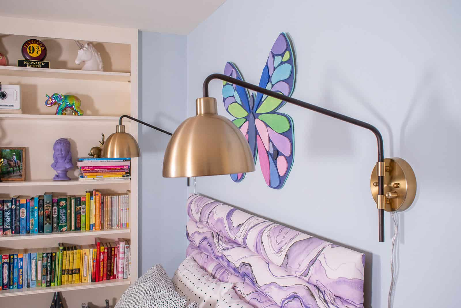 sconces over the bed