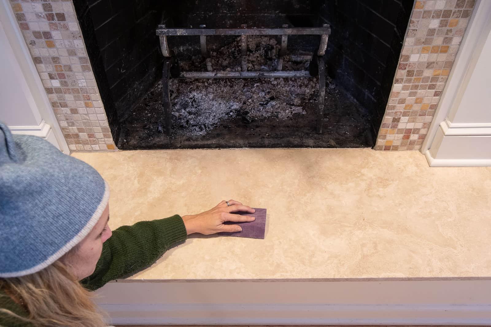 lightly sand the tile