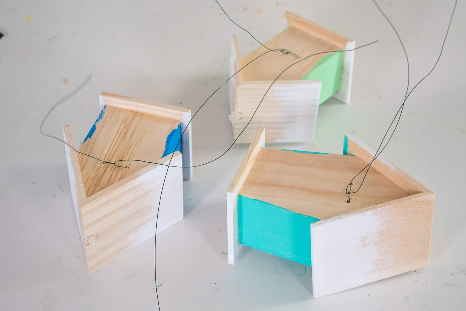 attach wire to the back of the wooden houses