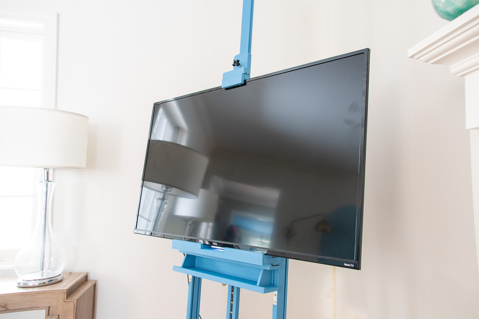 Support below television easel