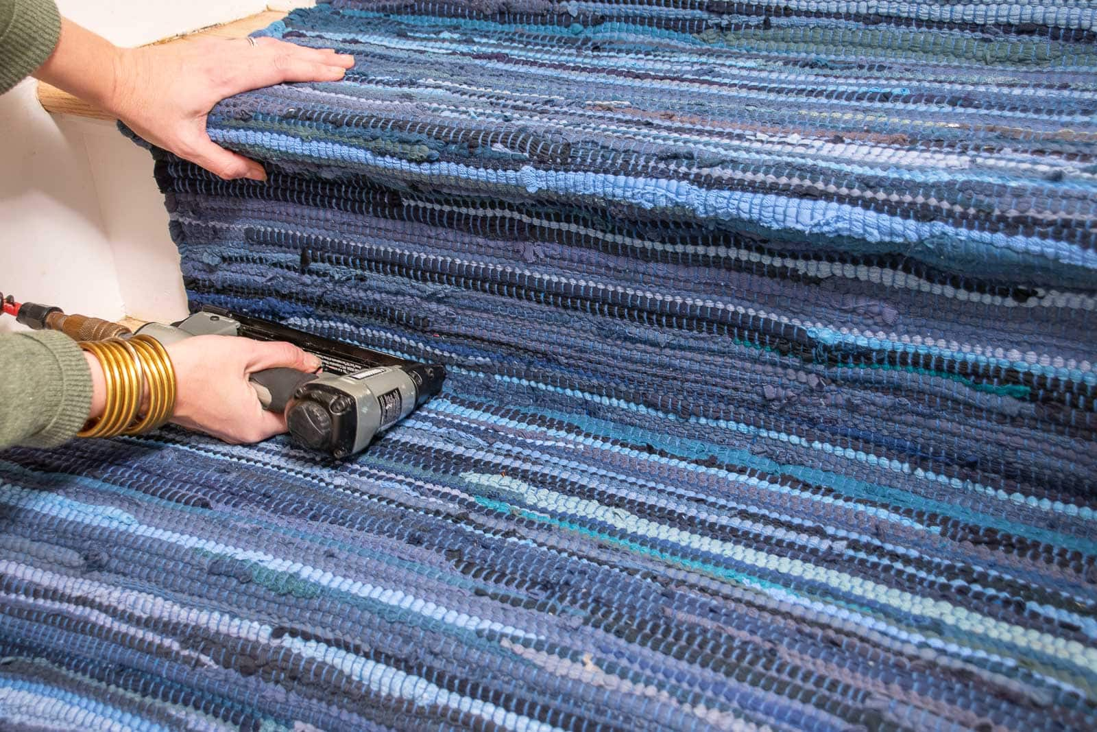 staple the corner of the rug
