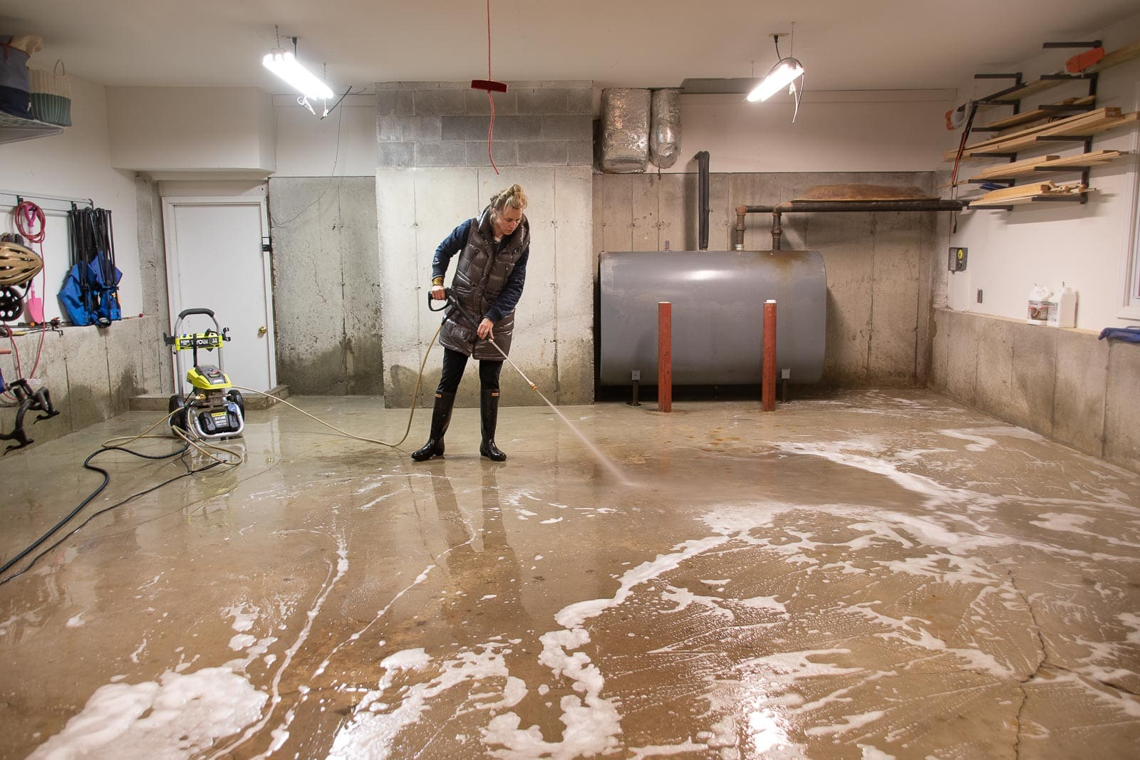 power washing and degreasing the garage