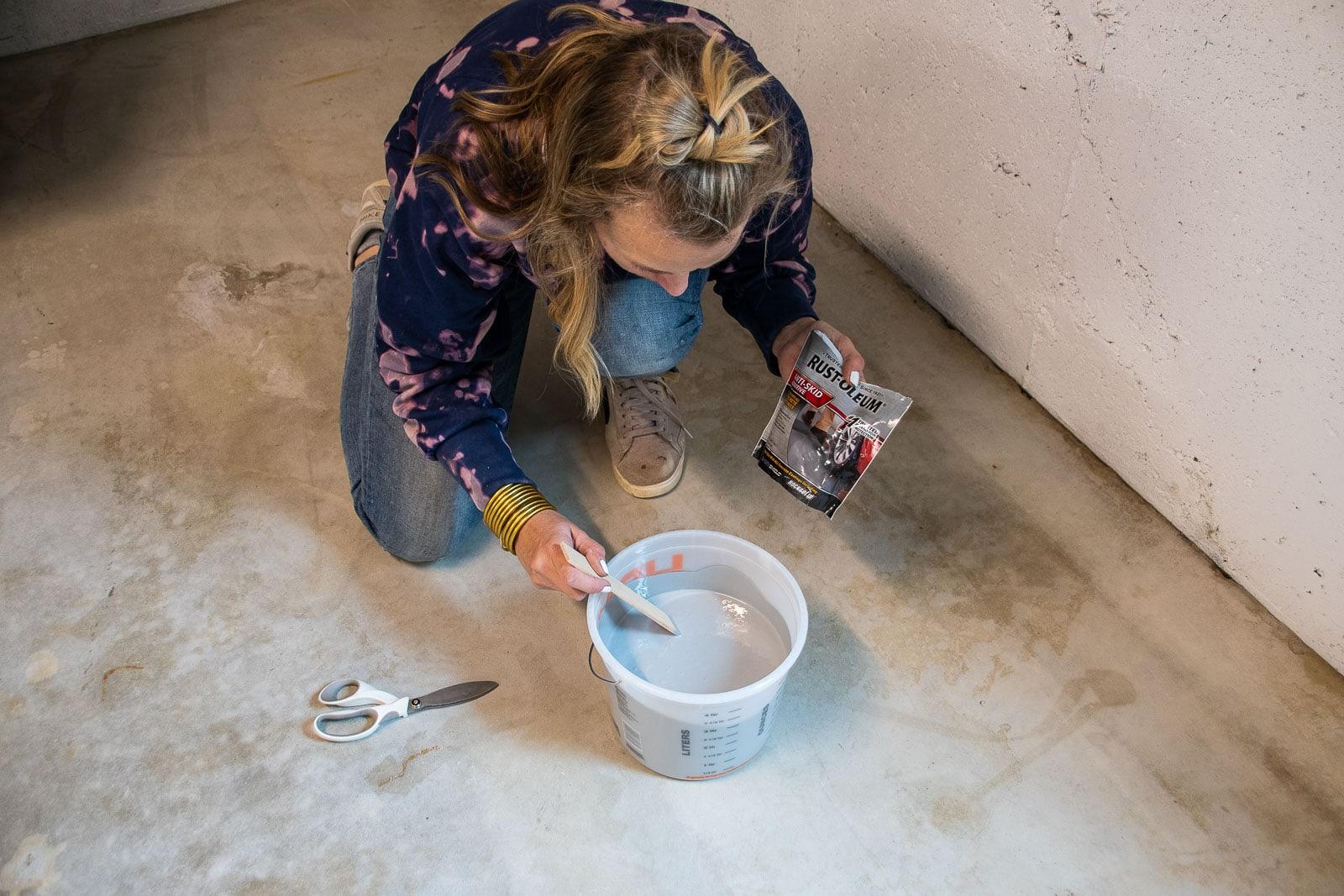 adding the anti skid powder to floor paint