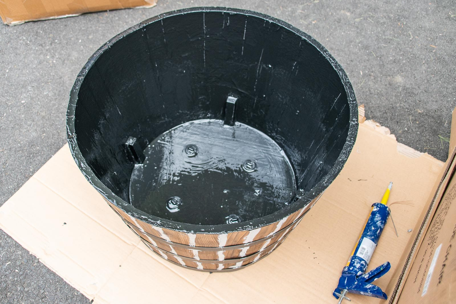 paint the inside of the barrel planter with flex sael