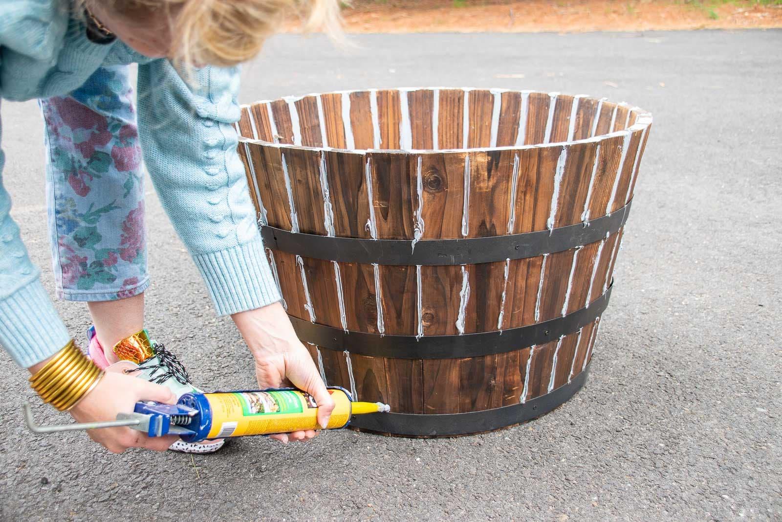 caulk the seams of the barrel planter