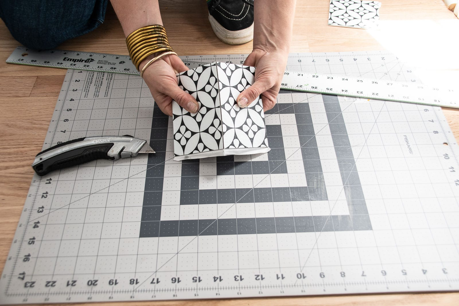 cutting the adhesive tile