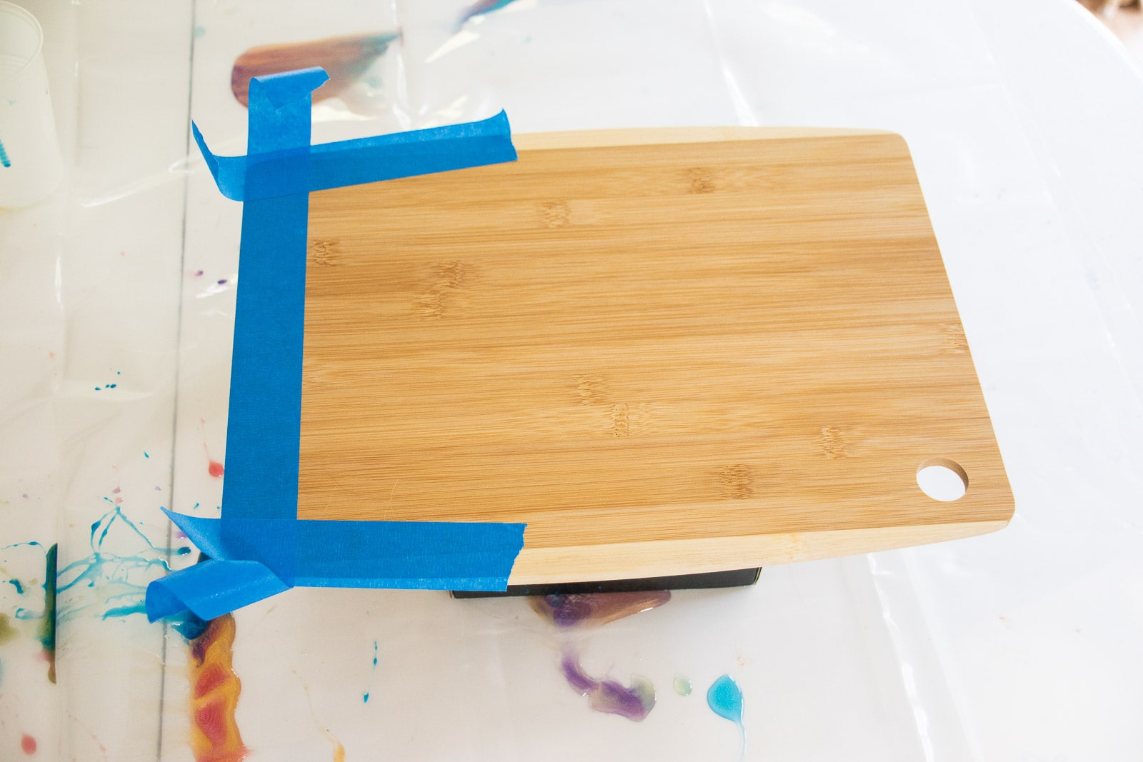 sand and tape the cutting board